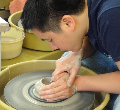 hands-on teaching - pottery wheel class in session