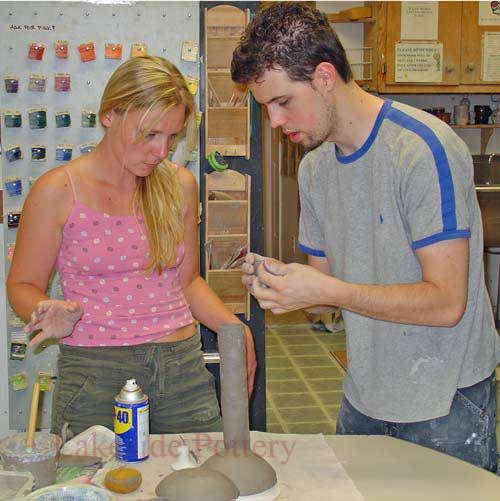 hand building instructor and student