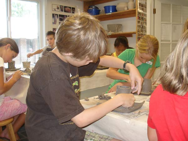 boys sculpting with clay - lakeside pottery summer camps