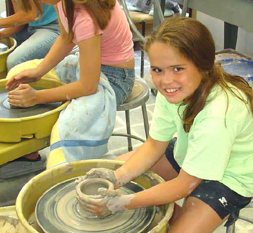 Popular summer camp - kid using the potter's wheel