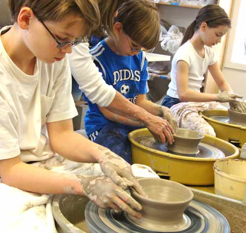 group kids  pottery wheel