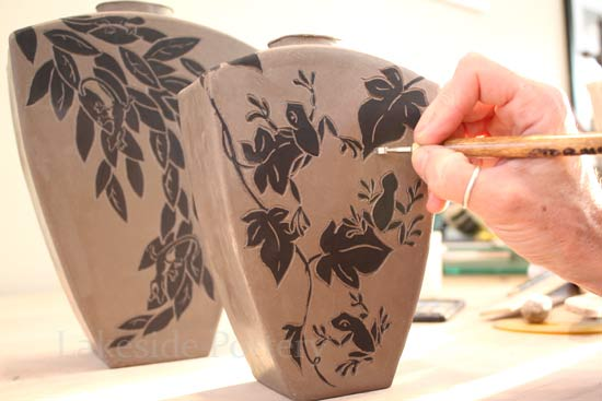 carving sgraffito on clay