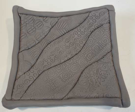 Clay quilt with surface texture pattern
