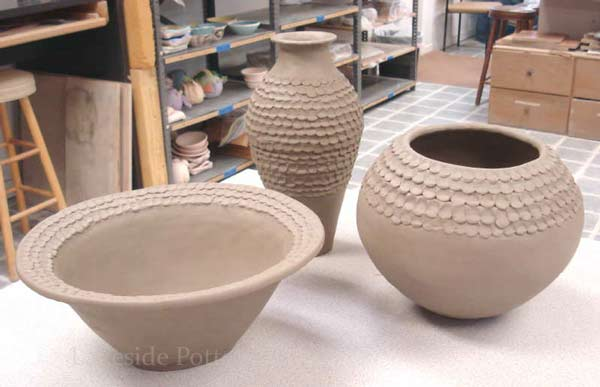 set of large coil construction clay pots