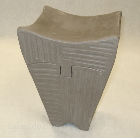 tall carved clay box with puzzle lid