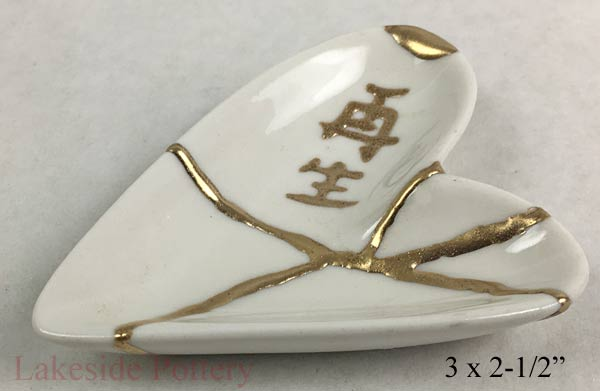"Kintsugi Heart shaped ring dish with ""Rebirth"" in Japanese characters"