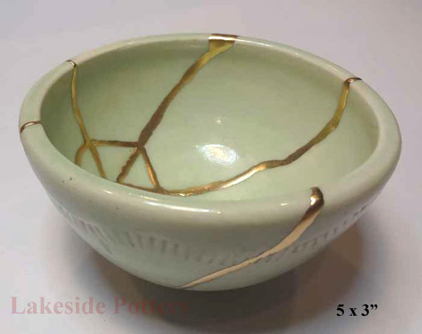 kintsugi repair - hand thrown altered bowl mended with gold for sale