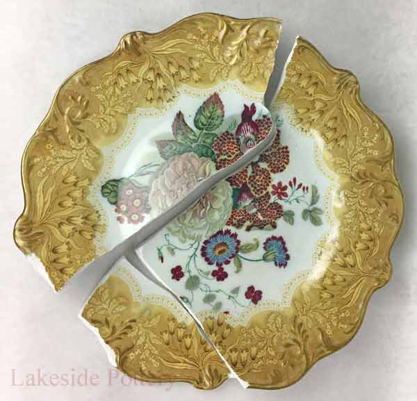 Broken Antique plate with missing segment