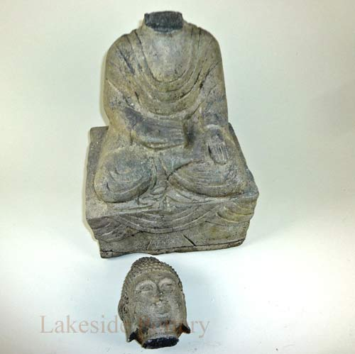 Buddha garden stone statue with broken head and missing ear