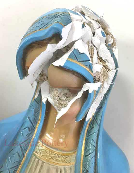 Plaster religious statue broken with missing pieces